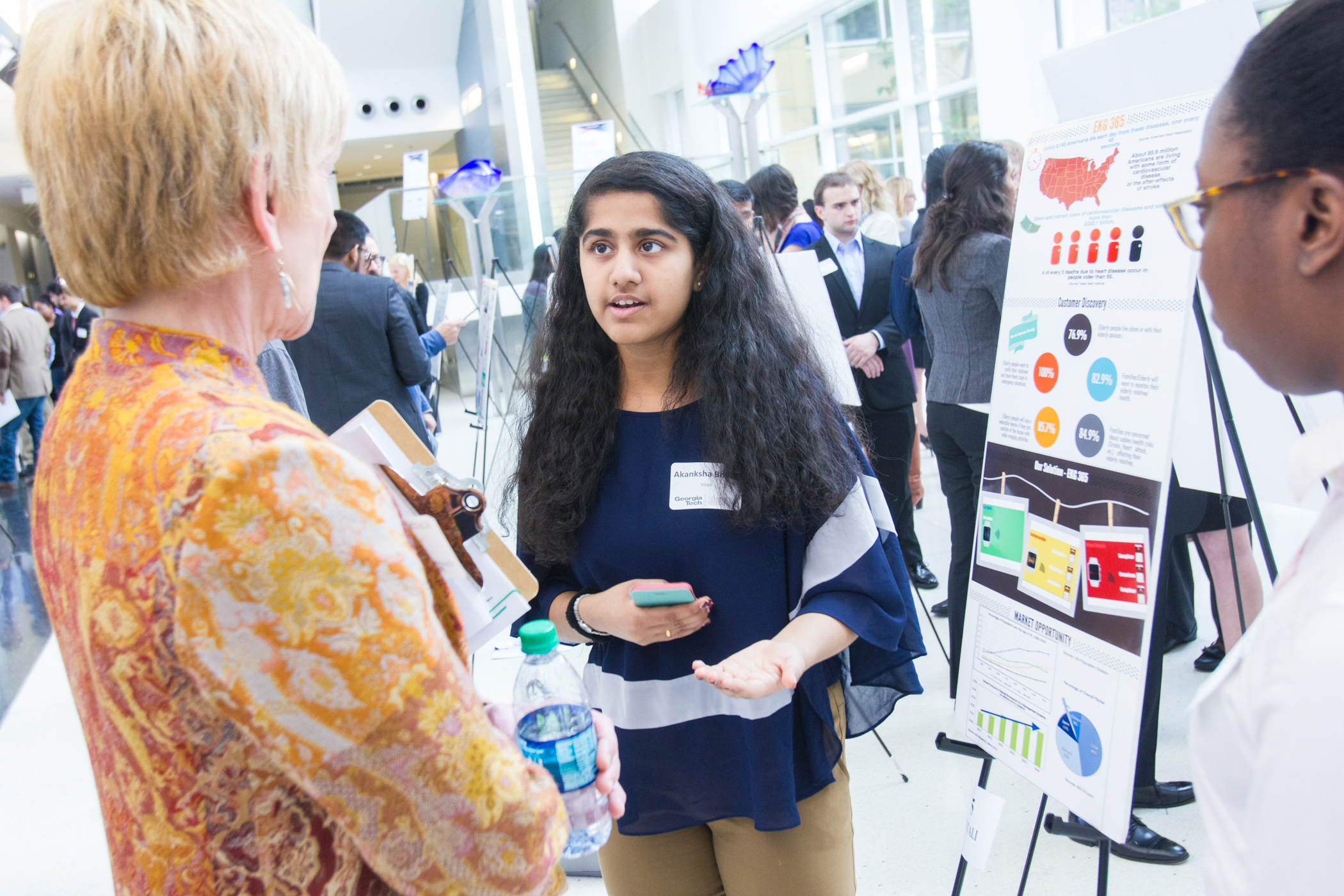 Students present business solutions at the poster showcase