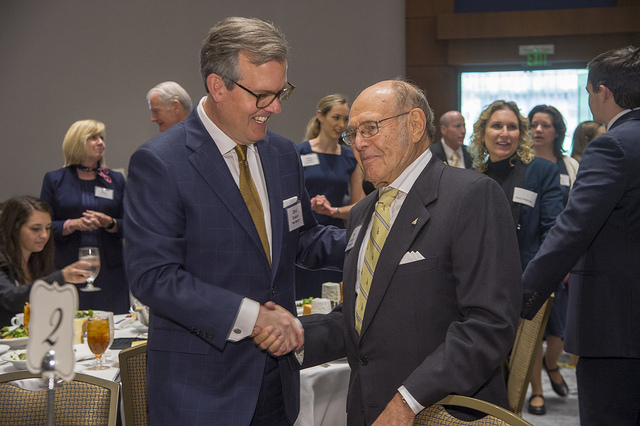 Scheller College of Business Advisory Board member David Rowland (left) greets Ernest Scheller, Jr. (right).