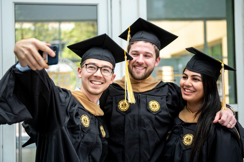 Full-time MBA students celebrate their commencement with a selfie.