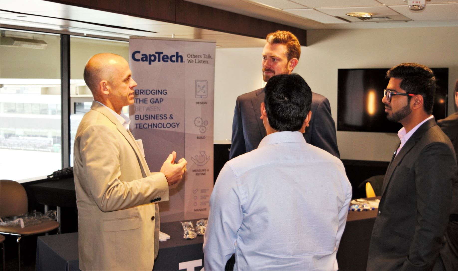 Students meet with a CapTech representative.