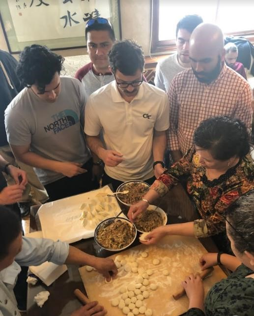 The MBA international practicum participants learn how to make dumplings.