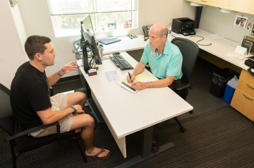 stan broome offers career advise to student Max Rehberger.