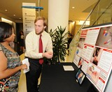 Jacob Thompson explains the breathing tube technology of his team, first-place winner MAID, during a product showcase reception of the Georgia Tech Business Plan Competition.