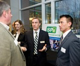 The SPi team explaining their business concept at the 2011 Business Plan Competition Reception. The 2012 event on March 1 is open to the public.