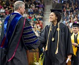 Elana Burton is congratulated by President Bud Peterson during graduation ceremony.