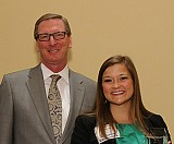 Scheller College Advisory Board Chairman Stephen Deedy, IMGT 1981, presents junior business major Hannah Siwik with The Dow Chemical – P.C. McCutcheon Prize for Outstanding Student Achievement.