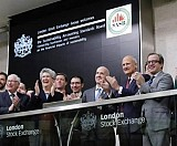 Jeffrey Hales (center) and members of the Sustainability Accounting Standards Board ring the opening bell at the London Stock Exchange.