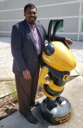 Chuck Easley with Buzz Statue