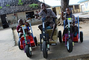 Patients in Kenya smile after receiving Mobility Carts donated by MedShare. (Courtesy Medshare)