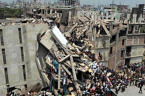Rescuers work at the collapsed Rana Plaza building in Dhaka in 2013. Photograph: ZUMA/REX