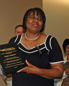 Raziya Chapman accepts a plaque for her 32 years of service to Georgia Tech College of Management.