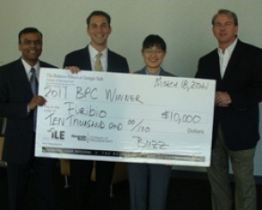 Puribio won both First Place ($10,000) and Most Innovative ($10,000) awards in the 2011 Georgia Tech Business Plan Competition. From left to right: Manish Gupta, Daniel Eyrich and Jane Kang with competition judge Rusty Pickering.