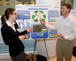 Nicole Sullivan and Ryan Ravenelle present their Urban RePeel concept to judges at the Poster Showcase of the Ideas to SERVE Competition.