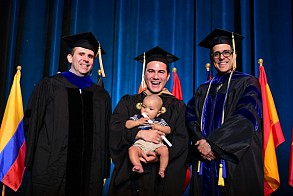 Cory O'Brien maintained full-time student status while serving as a full-time dad during the MBA program and celebrates with his son, Graylan.