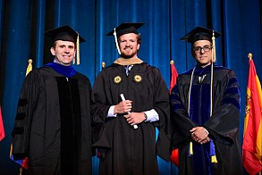 Trevor Clark is congratulated by Professors Jonathan Clarke and Omar Rodriguez-Vila at the MBA Graduation Ceremony.