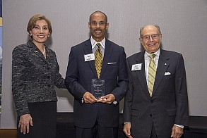 Kevin Stacia (center), Corporate Relations Manager, is awarded the Ernest Scheller, Jr. Prize by Dean Maryam Alavi (left) and Ernest Scheller, Jr. (right).