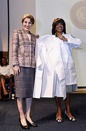"Scheller College of Business Dean Maryam Alavi and Morehouse School of Medicine President and Dean Dr. Valerie Montgomery Rice introduce the ""White Coats and Yellow Jackets"" partnership."