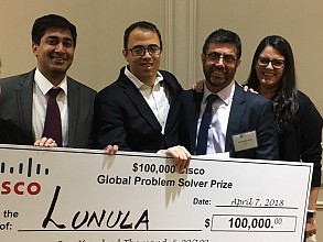 MBA student Prateek Mittal and biomedical engineering Ph.D. student Robert Mannino celebrate Lunula's $100K win with Cisco representatives Harbrinder Kang and Shawna Darling.
